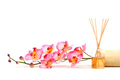 Pink orchid. Fragrance sticks and spa towel Royalty Free Stock Image