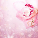 Pink orchid and wedding ring Stock Photo