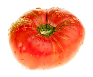 Pink organic tomato. Raw ripe pink organic tomato isolated on white royalty free stock photo