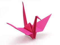 Pink origami bird. On white background Stock Photos