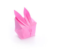 Pink origami bunny on white Stock Photography