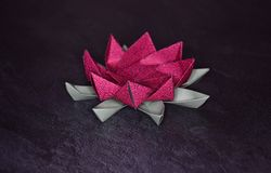 Pink Origami Lotus Flower - Paper Art on Textured Background. Pink Origami Lotus Flower - Arts and Crafts stock photography