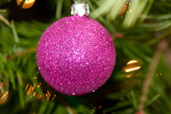 Pink ornament. In the shape of a ball with a sparkling exterior Stock Photography