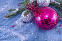 Pink ornament Christmass ball with a fir tree. On white table cloth royalty free stock images