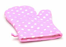 Pink oven glove. Pink polka dot oven glove isolated on white Stock Photography