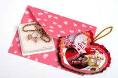 Pink packet with gift for Valentine's Stock Image