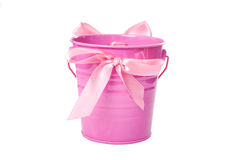 Pink pail with ribbon. Pink metal pail with pink ribbon isolated on white stock photo