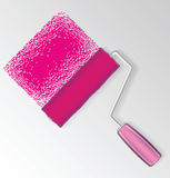 Pink paint roller Royalty Free Stock Image