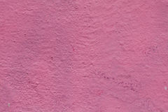 Pink paint street wall texture, aged cement surface. macro view Royalty Free Stock Photo