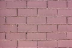Pink painted brick wall. Monochrome stock photo