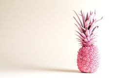 Pink painted pineapple on a white background Stock Image