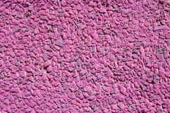 Pink painted  stone mosaic on the wall Royalty Free Stock Images