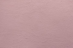 Pink painted stucco wall. Background texture Royalty Free Stock Photo