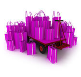 Pink pallet truck full of pink shopping bags Royalty Free Stock Images