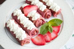 Pink pancakes with strawberries, five french style crepes Royalty Free Stock Photos
