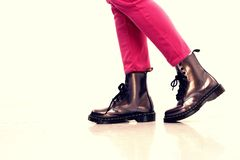 Pink pants and shiny leather boots Stock Photography