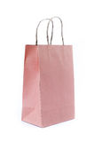Pink paper bag on white background Stock Photos