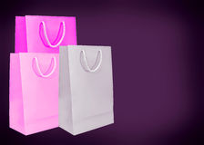 Pink paper bags on dark background. Royalty Free Stock Image