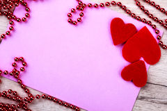 Pink paper with bead garland. Royalty Free Stock Images