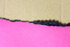Pink paper and burnt cardboard Stock Photography
