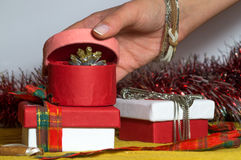 Pink paper Christmas box is being opened Royalty Free Stock Images