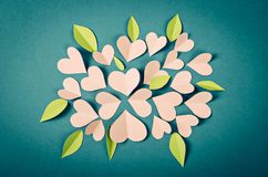 Pink paper cut heart shape and leaf. Royalty Free Stock Image