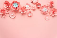 Pink paper flowers on the pink background stock photos