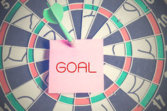 Pink paper with goal text pierced on dart Royalty Free Stock Image