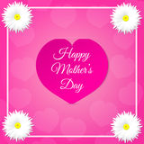 Pink paper heart with congratulations Happy Mother's DAY inserted in the notch of the paper sheet  with flowers and frame. Royalty Free Stock Photography