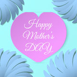 Pink paper heart with congratulations Happy Mother's DAY inserted in the notch of the paper sheet  with flowers. Royalty Free Stock Photography