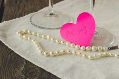 Pink paper heart with love confession and pearls Royalty Free Stock Photo