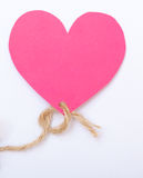 Pink paper heart with string symbol love valentine's day Stock Photos