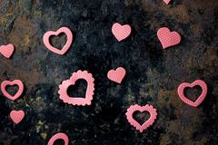 Pink paper hearts on black board. Pink paper hearts on black board - Valentine`s day background Stock Photo