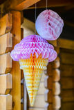 Pink paper ice cream. Hanging on a wooden girder Stock Image