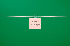 "Pink paper note on clothesline with text ""Good Morning"" Royalty Free Stock Photo"