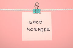 "Pink paper note on clothesline with text ""Good Morning"" Royalty Free Stock Images"