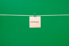 Pink paper note on clothesline with text Summer Stock Photo