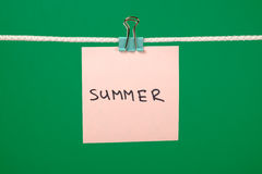 """Pink paper note on clothesline with text """"Summer"""" stock photos"""
