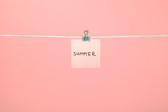 """Pink paper note on clothesline with text """"Summer"""" royalty free stock images"""