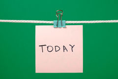 """Pink paper note hanging on the string with text """"Today"""" Royalty Free Stock Images"""