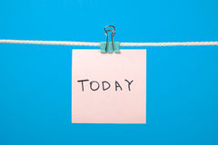 """Pink paper note hanging on the string with text """"Today"""" Royalty Free Stock Image"""