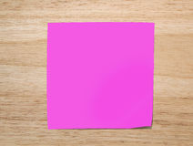 Pink  paper note on Texture of wood Royalty Free Stock Photos