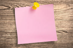 Pink paper note  on wood, clipping path. Royalty Free Stock Photography