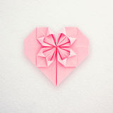 A pink paper origami heart Stock Images