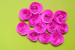 Pink paper rose isolated. On green background Royalty Free Stock Photos