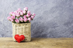 Pink paper rose in weave basket on old wood Royalty Free Stock Photo