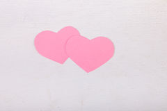 Pink paper Saint Valentines hearts. On white wood texture background Royalty Free Stock Photos