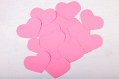 Pink paper Saint Valentines hearts. On white wood texture background Royalty Free Stock Photo