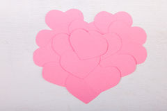 Pink paper Saint Valentines hearts. On white wood texture background Stock Images