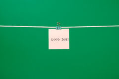 Pink paper sheet on the string with text Good Job royalty free stock image